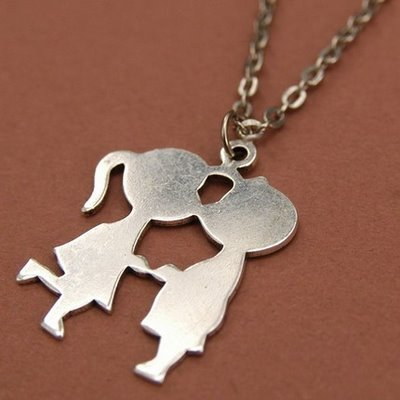 Boy kisses girl necklace